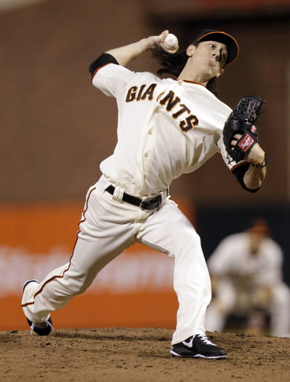 San Francisco Giants pitcher Tim Lincecum delivers in the sixth inning during Game 2 of the National League division baseball series against the Cincinnati Reds in San Francisco, Sunday, Oct. 7, 2012. (AP Photo/Marcio Jose Sanchez)