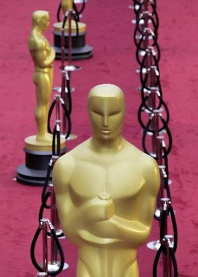 Oscar statues line the red carpet in anticipation of tonight's 84th Academy Awards in Los Angeles. (AP)