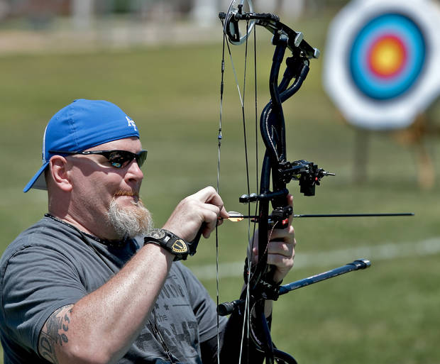 Keith Sekora prepares his arrow while competing in the archery event during the Endeavor Games at the University of Central Oklahoma on Friday, June 7, 2013 in Edmond, Okla.  Photo by Chris Landsberger, The Oklahoman