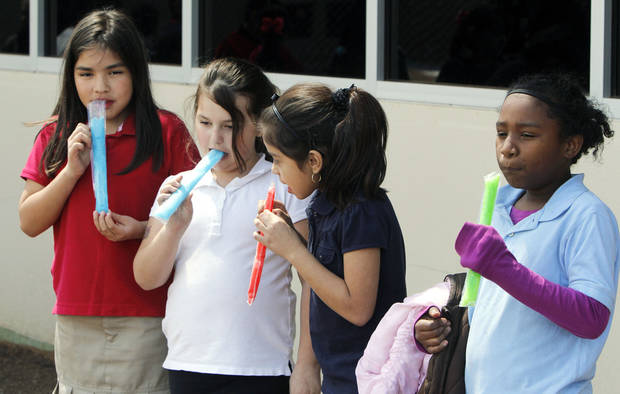 Third graders Natalie Anchondo, left, Stevi Haggard, Xitlalih Chairez, and Tyjhiana Wolf eat popsicles as a reward for studying for state exams at Coolidge Elementary School in Oklahoma City, OK, Thursday, April 4, 2013,  By Paul Hellstern, The Oklahoman