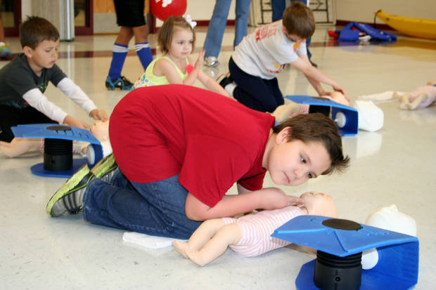 Julian Lautzenheiser, 9, practices CPR  during the Cleveland County Family YMCA's Healthy Kids Day on Saturday. Photo by Tami Althoff, for The Oklahoman <strong>Tami Altoff</strong>
