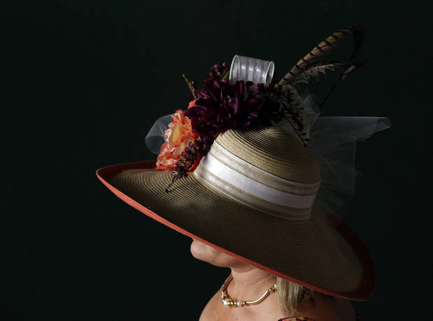 A spectator wears a fancy hat before the 138th Kentucky Derby horse race at Churchill Downs Saturday, May 5, 2012, in Louisville, Ky. (AP Photo/Matt Slocum)  ORG XMIT: DBY165