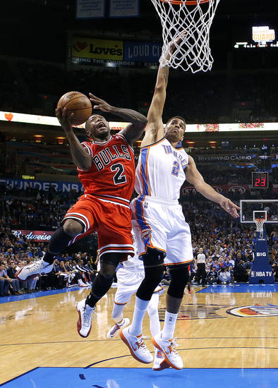 Chicago's Nate Robinson (2) shoots a lay up as Oklahoma City's Thabo Sefolosha (2) defends during the NBA game between the Oklahoma City Thunder and the Chicago Bulls at Chesapeake Energy Arena in Oklahoma City, Sunday, Feb. 24, 2013. Photo by Sarah Phipps, The Oklahoman