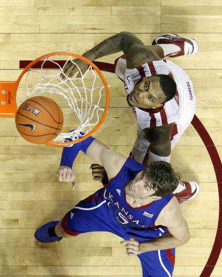 Oklahoma's Romero Osby (24) and Kansas' Jeff Withey (5) try for a rebound during the second half as the University of Oklahoma Sooners (OU) defeat the Kansas Jayhawks (KU) 72-66 in NCAA, men's college basketball at The Lloyd Noble Center on Saturday, Feb. 9, 2013 in Norman, Okla. Photo by Steve Sisney, The Oklahoman