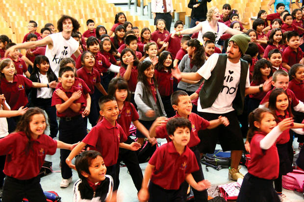 At selected schools, the Be Kind People Project holds high-energy school assemblies featuring performances by the Be Kind Crew, a group of energetic and gifted young performers that use classical technique, urban style, hip hop rhythms and slam poetry to communicate the organization's kindness messages. Shown here at a Los Angeles school assembly (left to right): Vo Vera, Codi Starner and Vincent Calleros from The Be Kind Crew. Photo provided. <strong></strong>
