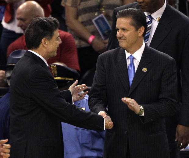 Louisville head coach Rick Pitino, left shakes hands with Kentucky head coach John Calipari before the first half of an NCAA Final Four semifinal college basketball tournament game Saturday, March 31, 2012, in New Orleans. (AP Photo/Bill Haber)