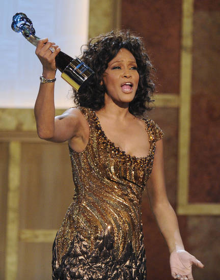 FILE - In this Saturday, Jan. 16, 2010 file photo, Whitney Houston accepts an award at the Warner Theatre during the 2010 BET Hip Hop Honors in Washington. Houston died Saturday, Feb. 11, 2012, she was 48. (AP Photo/Nick Wass) ORG XMIT: NY121