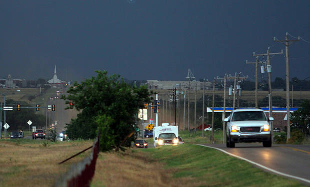 Many cars headed south out of Piedmont on State Highway 4 as a thunderstorm producing large hail approaches Tuesday. PHOTO BY HUGH SCOTT, FOR THE OKLAHOMAN