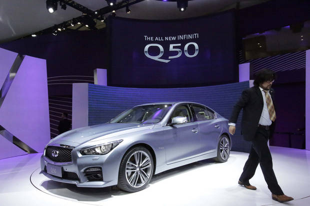 Infiniti's new Q50 is displayed at the Shanghai International Automobile Industry Exhibition (AUTO Shanghai) media day in Shanghai, China Saturday, April 20, 2013. (AP Photo/Eugene Hoshiko)