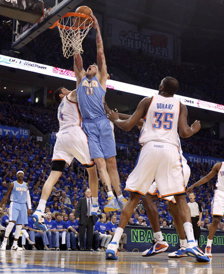 Denver's Chris Andersen (11) dunks the ball between Oklahoma City's Nick Collison (4) and Kevin Durant (35) during the NBA basketball game between the Denver Nuggets and the Oklahoma City Thunder in the first round of the NBA playoffs at the Oklahoma City Arena, Sunday, April 17, 2011. Photo by Bryan Terry, The Oklahoman