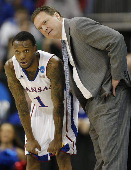 Kansas coach Bill Self, right, talks with guard Naadir Tharpe (1) during the first half of a second-round game against Western Kentucky in the NCAA college basketball tournament at the Sprint Center in Kansas City, Mo., Friday, March 22, 2013. (AP Photo/Orlin Wagner)