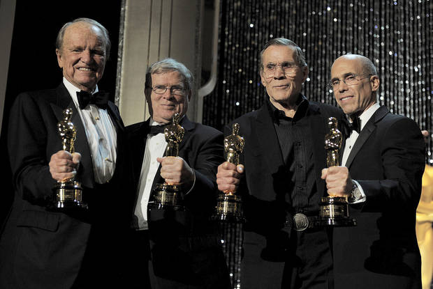 From left, award recipients George Stevens Jr., D.A. Pennebaker, Hal Needham and Jeffrey Katzenberg poses with their Oscar statuettes at the 4th Annual Governors Awards at Hollywood and Highland Center's Ray Dolby Ballroom on Saturday, Dec. 1, 2012, in Los Angeles. (Photo by Jordan Strauss/Invision/AP)