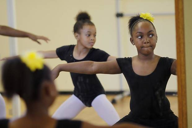 Akia Johnson, 8, left, and Michelle Taffe, 9,  during ballet practice for Metropolitan School of Dance  Saturday, May 7, 2011.  Photo by Doug Hoke, The Oklahoman