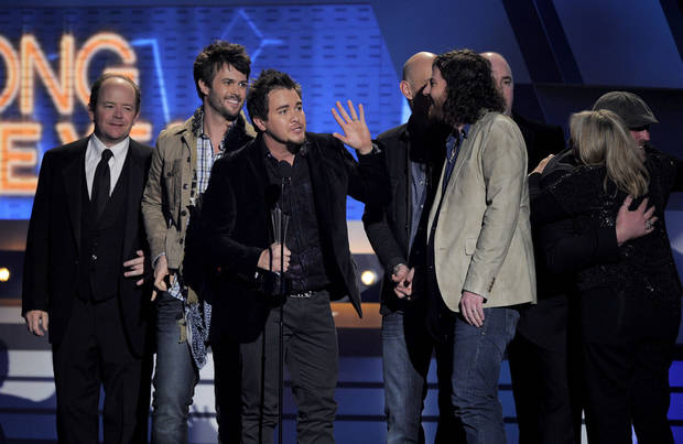 "Mike Eli of the Eli Young Band accepts the award for song of the year for ""Crazy Girl"" at the 47th Annual Academy of Country Music Awards on Sunday, April 1, 2012 in Las Vegas. (AP Photo/Mark J. Terrill) <strong>Mark J. Terrill - AP</strong>"