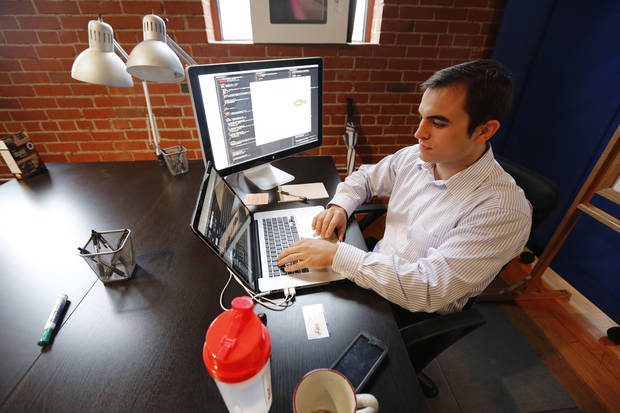 Jared Rader, CEO of Littlefish works at VENTURESPUR in Oklahoma City. PHOTO BY STEVE GOOCH, THE OKLAHOMAN <strong>Steve Gooch - The Oklahoman</strong>