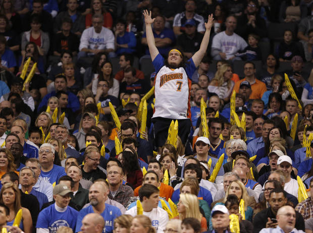 Zebulun Benbrook, of Oklahoma City, cheers for Golden State during an NBA basketball game between the Oklahoma City Thunder and the Golden State Warriors at Chesapeake Energy Arena in Oklahoma City, Sunday, Nov. 18, 2012.  Photo by Garett Fisbeck, The Oklahoman