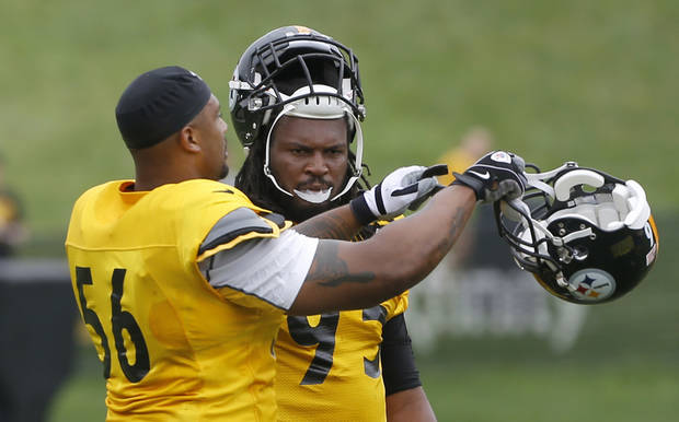 Pittsburgh Steelers outside linebacker LaMarr Woodley, left, gives linebacker Jarvis Jones a few pointers at practice during NFL football training camp at the team's training facility in Latrobe, Pa. on Wednesday, July 31, 2013 . (AP Photo/Keith Srakocic)