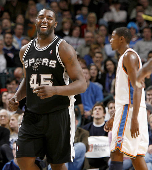San Anotnio's DeJuan Blair smiles as Oklahoma City's Kevin Durant walks off the court during the NBA basketball game between the Oklahoma City Thunder and the San Antonio Spurs at the Ford Center in Oklahoma City, Wednesday, January 13, 2010. Photo by Bryan Terry, The Oklahoman