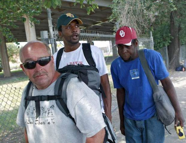 "Antwone Taulton, center, walks with Terry Potts, left, and Ralph ""Scooby"" Crumble, two of the subjects in his new documentary film, in downtown Oklahoma City. PHOTO BY JOHN CLANTON, THE OKLAHOMAN <strong>JOHN CLANTON - JOHN CLANTON</strong>"