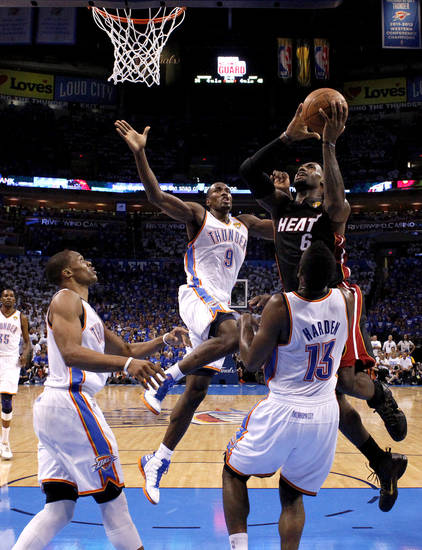 Miami's LeBron James (6) shoots in between Oklahoma City's Russell Westbrook (0), Serge Ibaka (9) and James Harden (13) during Game 2 of the NBA Finals between the Oklahoma City Thunder and the Miami Heat at Chesapeake Energy Arena in Oklahoma City, Thursday, June 14, 2012. Photo by Sarah Phipps, The Oklahoman