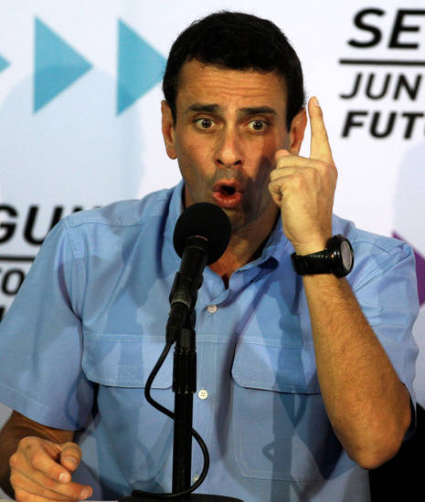 Venezuela's opposition leader Henrique Capriles speaks during a news conference in Caracas, Venezuela, Tuesday, Jan. 8, 2013. Capriles said that the Supreme Court should rule in a dispute between the opposition and President Hugo Chavez's government over whether the ailing leader's inauguration can legally be postponed. Capriles said the constitution is clear that the current presidential term ends on Jan. 10. Chavez remains in Havana after undergoing his fourth cancer surgery on Dec. 11 and hasn't spoken publicly in a month. (AP Photo/Fernando Llano)