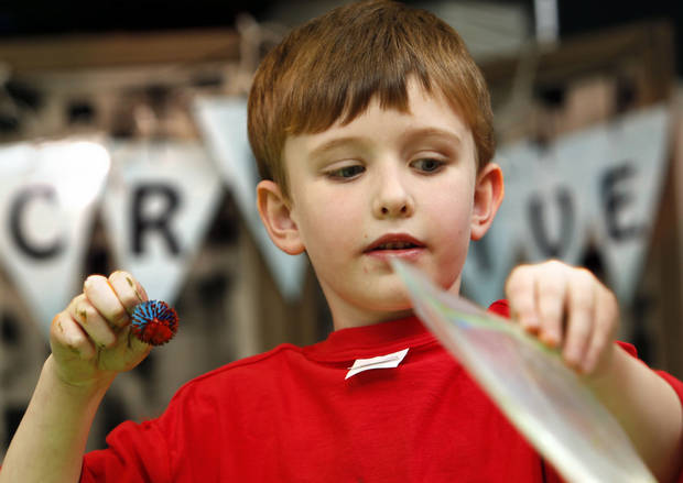 Jack Bushnell, 6, uses a plastic bag to make a painting at the after-school special story time at the Norman Public  Library. PHOTO BY STEVE SISNEY, THE OKLAHOMAN <strong>STEVE SISNEY</strong>