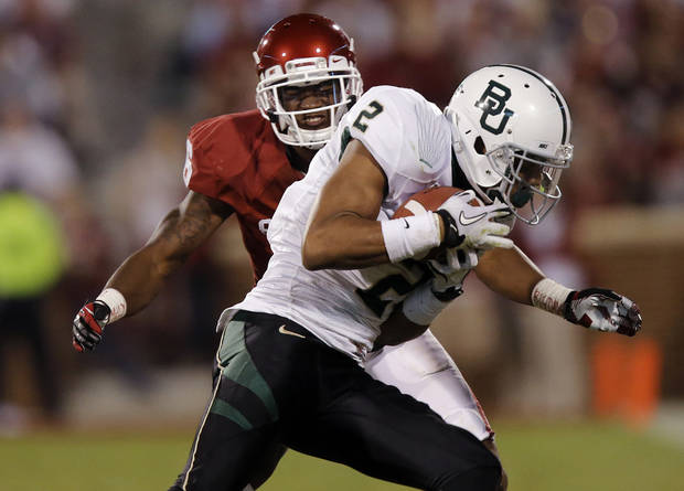 Oklahoma's Demontre Hurst (6) prepares to hit Baylor's Terrance Williams (2) during the college football game between the University of Oklahoma Sooners (OU) and Baylor University Bears (BU) at Gaylord Family - Oklahoma Memorial Stadium on Saturday, Nov. 10, 2012, in Norman, Okla.  Photo by Chris Landsberger, The Oklahoman