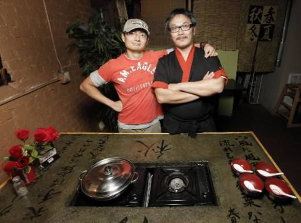 Dean Chen, left, and David Tjie are co-owners of Tokyo Pot in Stillwater. The two Indonesian friends met in California.