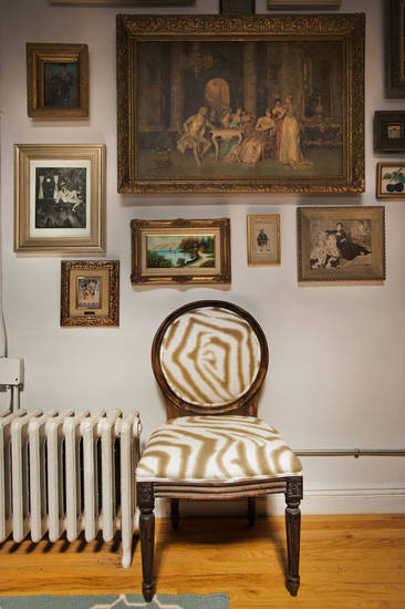 An antique chair that designer Christian Siriano restored himself is featured in his New York City apartment, September 11, 2012. (Karl Merton Ferron/Baltimore Sun/MCT)