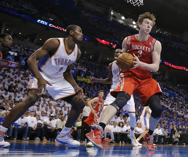 Oklahoma City's Serge Ibaka (9) defends on Houston's Omer Asik (3) during Game 2 in the first round of the NBA playoffs between the Oklahoma City Thunder and the Houston Rockets at Chesapeake Energy Arena in Oklahoma City, Wednesday, April 24, 2013. Photo by Chris Landsberger, The Oklahoman