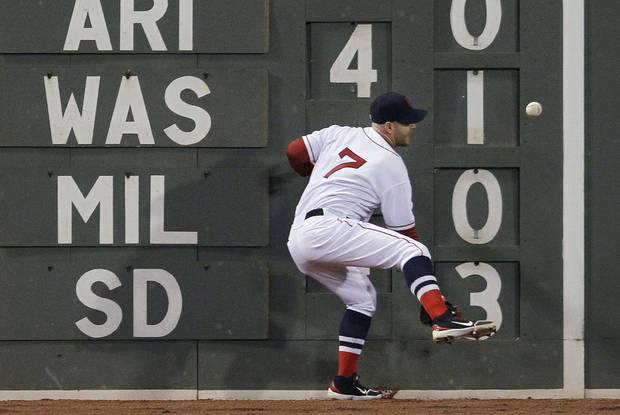 Boston Red Sox left fielder Cody Ross cannot get to a double off the wall by Oakland Athletics' Yoenis Cespedes during the fourth inning of a baseball game at Fenway Park in Boston, Wednesday, May 2, 2012. (AP Photo/Elise Amendola)
