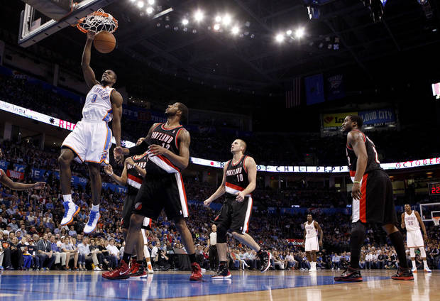 Oklahoma City's Serge Ibaka (9) dunks the ballduring the NBA basketball game between the Oklahoma City Thunder and the Portland Trailblazers at Chesapeake Energy Arena in Oklahoma City, Sunday, March 18, 2012. Photo by Sarah Phipps, The Oklahoman.