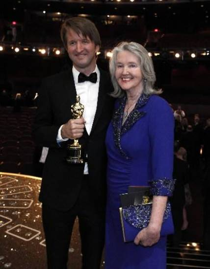 "Best director winner Tom Hooper, who helmed ""The King's Speech,"" and his mom Meredith Hooper pose backstage. Hooper credited his mom with recommending he make the film ""The King's Speech,"" which won best picture."