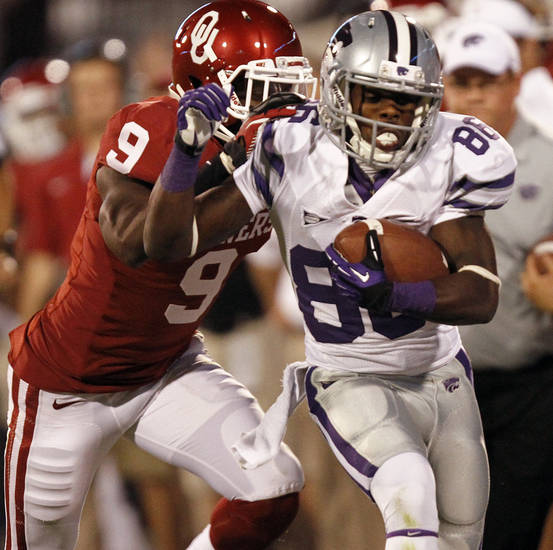 Kansas State's Tramaine Thompson (86)  runs past Oklahoma's Gabe Lynn (9) during the college football game between the University of Oklahoma Sooners (OU) and the Kansas State University Wildcats (KSU) at the Gaylord Family-Memorial Stadium on Saturday, Sept. 22, 2012, in Norman, Okla. Photo by Chris Landsberger, The Oklahoman