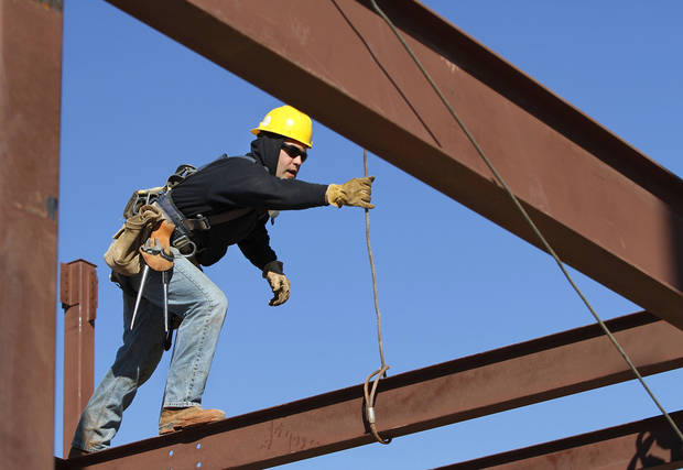 A construction worker is shown at Soldier Creek Elementary School.