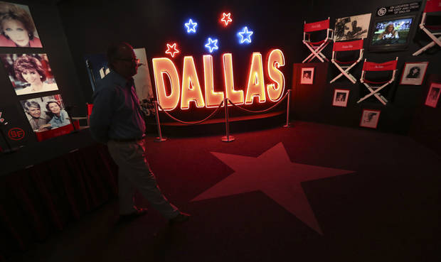 In this photo made Tuesday, Nov. 13, 2012, a tourist looks at the Dallas TV show museum at Southfork Ranch in Parker, Texas. Tourists have been flocking to Southfork Ranch since the early years of the classic series, which ran from 1978 to 1991. And a new �Dallas� starting its second season on TNT on Monday and the recent death of the show's star, Larry Hagman, who legendarily played conniving Texas oilman J.R. Ewing, have also spurred fans to visit. (AP Photo/LM Otero)