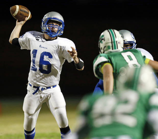Guthrie's Bryan Dutton (16) passes the ball during a high school football game between Bishop McGuinness and Guthrie at Bishop McGuinness Catholic High School in Oklahoma City, Friday, Oct. 26, 2012. Photo by Nate Billings, The Oklahoman
