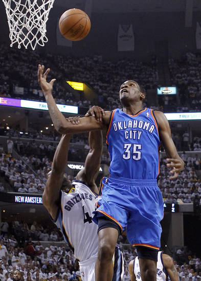 Oklahoma City Thunder forward Kevin Durant (35) is fouled by Memphis Grizzlies guard Sam Young (4) during the first half of Game 4 of a second-round NBA basketball playoff series on Monday, May 9, 2011, in Memphis, Tenn. (AP Photo/Lance Murphey)