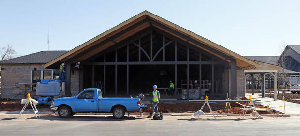 Workers renovate the former home of Crescent Market on the south side of Nichols Hills Plaza. Photo by NATE BILLINGS, The Oklahoman