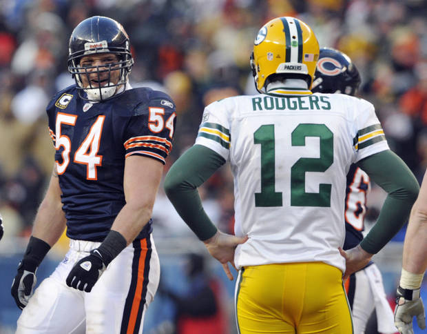 Chicago Bears linebacker Brian Urlacher (54) looks over at Green Bay Packers quarterback Aaron Rodgers (12) during the second half of the NFC Championship NFL football game Sunday, Jan. 23, 2011, in Chicago. (AP Photo/Jim Prisching)