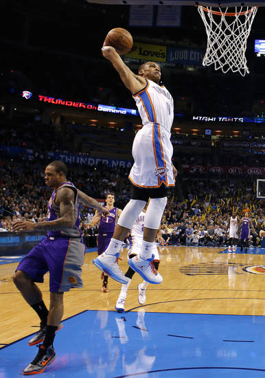 Oklahoma City&#039;s&#039; Russell Westbrook (0) dunks in front of Phoenix&#039;s Shannon Brown (26) during the NBA game between the Oklahoma City Thunder and the Phoenix Suns at theChesapeake Energy Arena, Friday, Feb. 8, 2013.Photo by Sarah Phipps, The Oklahoman