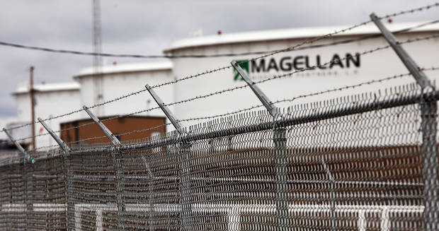 Security fences surround the perimeter of a Magellan oil storage tank facility south of Cushing. Residents and businesses of Cushing are preparing for the arrival of President Barack Obama this week. The president will make a brief stop at a TransCanada Corp. pipe yard northwest of town, as part of a four-state tour to promote the administration's energy  policy.  Ruth Ann Johnson, 73, who served 50 years as the town's librarian, said  the Payne County community of 8,000 will welcome President Obama on his first visit to Oklahoma after being elected in 2008.   Photo by Jim Beckel, The Oklahoman