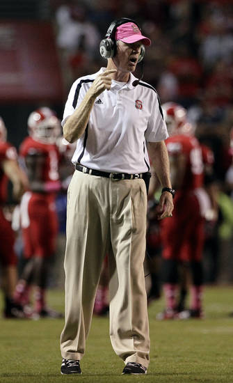 North Carolina State coach Tom O'Brien calls out during the second half of an NCAA college football game against Florida State in Raleigh, N.C., Saturday, Oct. 6, 2012. North Carolina State won 17-16. (AP Photo/Gerry Broome)