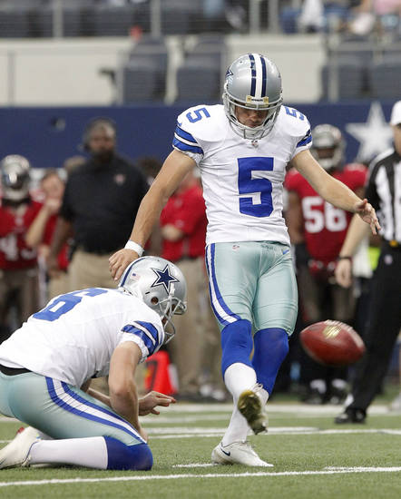 Dallas Cowboys punter Chris Jones (6) holds as quarterback Josh Freeman (5) kicks a field goal against the Tampa Bay Buccaneers during the second half of an NFL football game on Sunday, Sept. 23, 2012, in Arlington, Texas. (AP Photo/Tim Sharp)