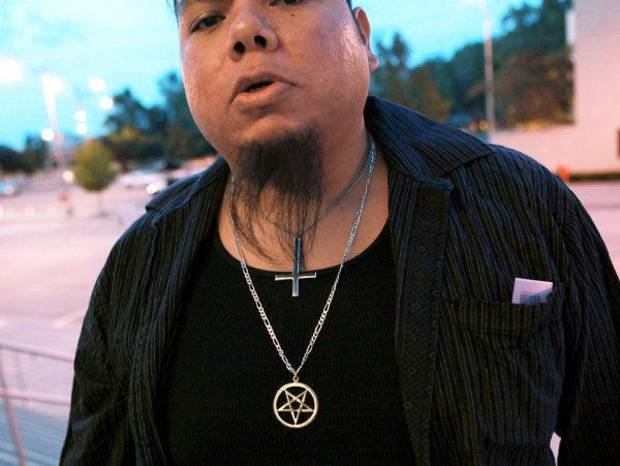 Eddie Harjo shows his necklaces as he enters the Civic Center Music Hall to attend a satanic demonstration by members of the Church of the IV Majesties at the Civic Center Music Hall in downtown Oklahoma City on Thursday, Oct. 21, 2010. Photo by John Clanton, The Oklahoman ORG XMIT: KOD