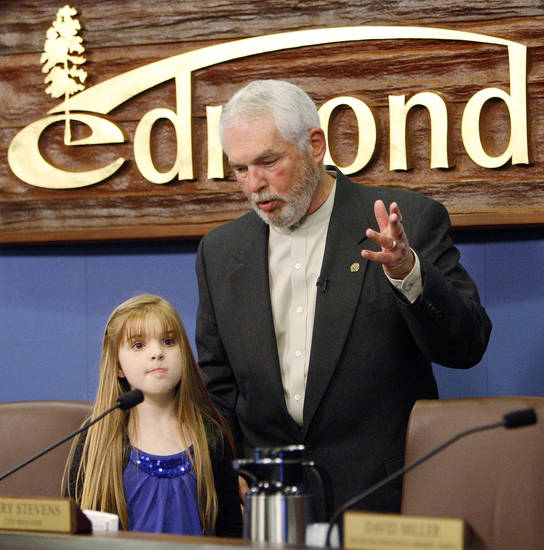 Charles Lamb talks with granddaughter Alexandra Austin, 9, before a ceremony to swear him in as mayor of Edmond at the city council chambers in Edmond, Okla., Monday, Nov. 14, 2011. Photo by Nate Billings, The Oklahoman