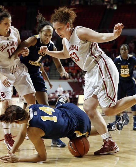 Oklahoma Sooner's Joanna McFarland (53) and West Virginia Mountaineers' Jess Harlee (14) go after the ball during the second half as the University of Oklahoma Sooners (OU) defeat the West Virginia Mountaineers 71-68 in NCAA, women's college basketball at The Lloyd Noble Center on Wednesday, Jan. 2, 2013  in Norman, Okla. Photo by Steve Sisney, The Oklahoman