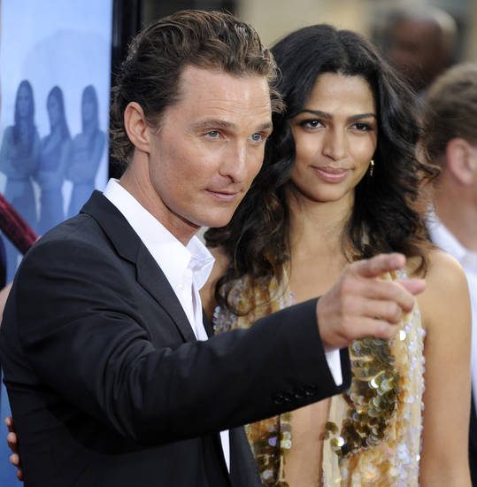 "Matthew McConaughey, left, star of ""Ghosts of Girlfriends Past,"" poses with his wife Camila Alves at the premiere of the film in Los Angeles, Monday, April 27, 2009. (AP Photo/Chris Pizzello) ORG XMIT: CACP118"