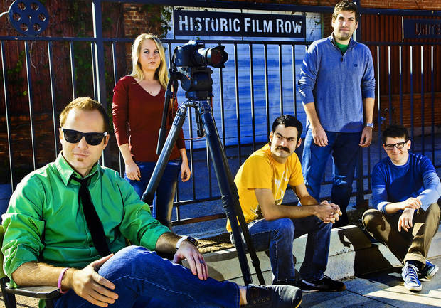 Director Kyle Roberts. left, poses for a photo with makeup artist Jenny Hausam, production assistant Jason Oser, editor Hal Gatewood, and writer/actor Lucas Ross, from left, in Oklahoma City's historic film row on Tuesday, Nov. 20, 2012, in Oklahoma City, Okla.   Photo by Chris Landsberger, The Oklahoman