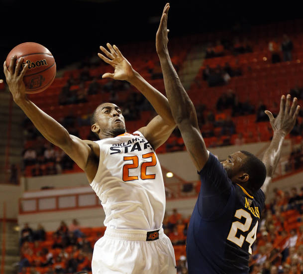 Oklahoma State's Markel Brown (22) takes a shot against West Virginia's Aaric Murray (24) during an NCAA men's basketball game between Oklahoma State University (OSU) and West Virginia at Gallagher-Iba Arena in Stillwater, Okla., Saturday, Jan. 26, 2013. Oklahoma State won, 80-66. Photo by Nate Billings, The Oklahoman